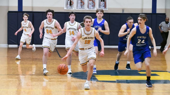 Lancaster senior Cameron Roudabush brings the ball up the court against Central Crossing in a OCC-Buckeye Division game Saturday night at LHS. The host Golden Gales defeated Central Crossing 63-41. -Jamie Potts/Eagle Gazette
