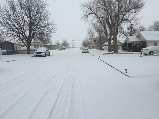 Snow covered an Artesia neighborhood on Valentine's Day. The New Mexico Public Regulation Commission is asking utilities for information about the impacts the storm had on costs and could have on ratepayers.