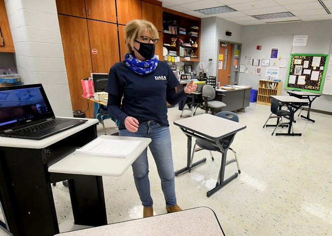 Ellen Connelly talks changes in her classroom at Dallastown Area Middle School Wednesday, Feb. 10, 2021. Desks in the classroom have been rearranged to accommodate social distancing. Bill Kalina photo