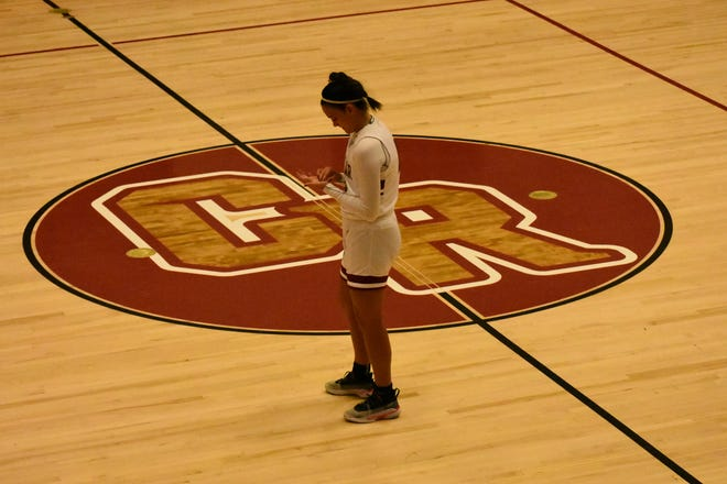 Logann Laws stands at mid court and looks at her hand prior to her senior night game against Pine View.