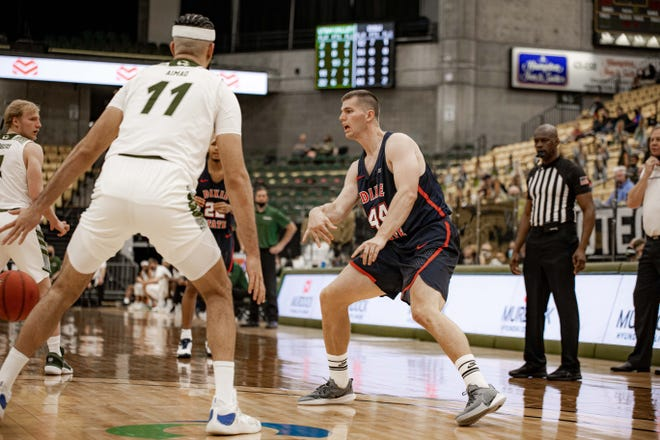 Dixie State's Hunter Schofield (center) scored a career-high 31 points against Utah Valley Saturday night.