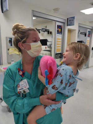 Emerson with Nurse Lacey at Wolfson Children's Hospital. Emerson is doing well after surgery and has returned to pre-school and all of her normal activities.