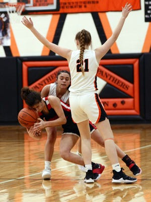 New Lexington's Aubri Spicer and Abby Wilson trap Crooksville's Lelila Kennedy during the Panthers' 58-27 win in a Division III sectional game on Feb. 3 in New Lexington.