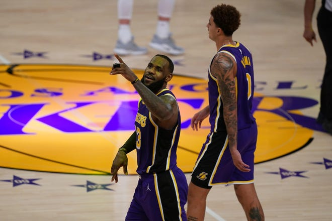 Los Angeles Lakers forward LeBron James (center) and forward Kyle Kuzma during the second half against the Memphis Grizzlies at Staples Center.