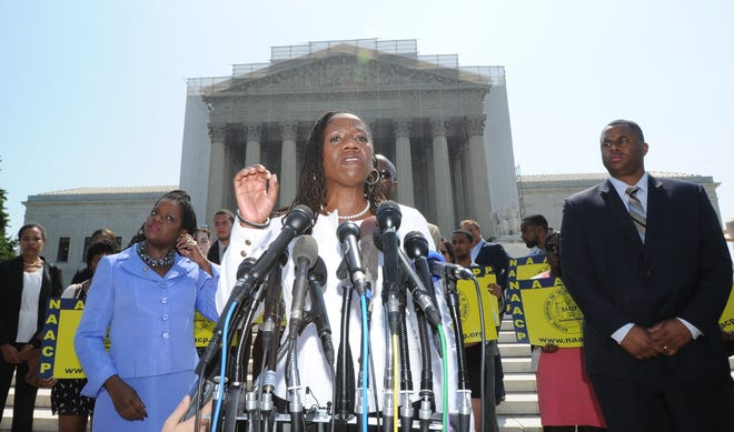 Sherrilyn Ifill, president and director-counsel of the NAACP Legal Defense and Education Fund, reacts to the Supreme Court ruling striking down a key piece of the Voting Rights Act.
