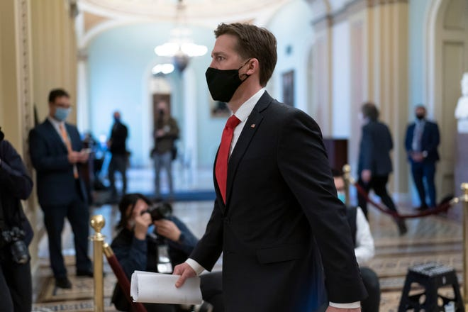 Sen. Ben Sasse, R-Neb., leaves the chamber as the Senate voted to consider hearing from witnesses in the impeachment trial of former President Donald Trump, at the Capitol in Washington, Saturday, Feb. 13, 2021.