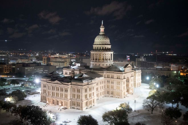 Austin, Texas Feb. 15, 2021: A rare winter snowfall measuring at least half a foot hits central Texas as the State Capitol and Congress Avenue becomes nearly impassable. Rolling power blackouts have been instituted  to save  critical electricity. (Bob Daemmrich/CapitolPressPhoto)  .