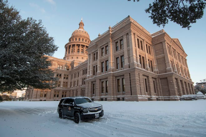 Austin, TX Feb 15, 2021: A Dept. of Public Safety vehicle guards the east entrance of the Texas Capitol Monday morning after an overnight winter storm blew into central Texas dropping 6-7 inches of snow.  Most offices and school will emain closed until warmer weather arrives later in the week. (Photo by Bob Daemmrich/CapitolPressPhoto