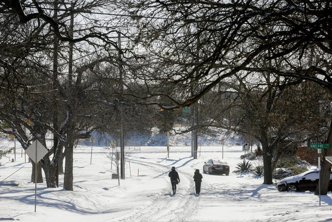 Snow covers Schieffer Avenue after a historic night of snowfall in Austin on Monday, Feb. 15, 2021.
