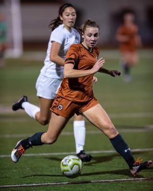 Skylar Zinnecker of Westwood chases down the ball, as Michelle Davidson pursues for Vandegrift. Westwood and Vandegrift played to a scoreless tie in a girls district soccer match at the Westwood Warrior Bowl on Jan. 25.