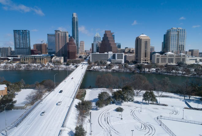 Snow and ice covers the Ann Richards Congress Avenue Bridge in Austin on Feb. 15.