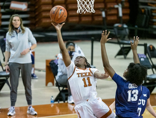 Texas guard Joanne Allen-Taylor puts up a shot up against TCU's Tavy Diggs in Austin on Jan. 20, 2021.  Texas and TCU's rematch on Wednesday has been postponed.