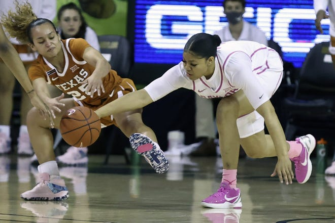 Baylor guard Trinity Oliver (right) and Texas guard Ashley Chevalier go after a loose basketball in Waco on Feb. 14, 2021.
