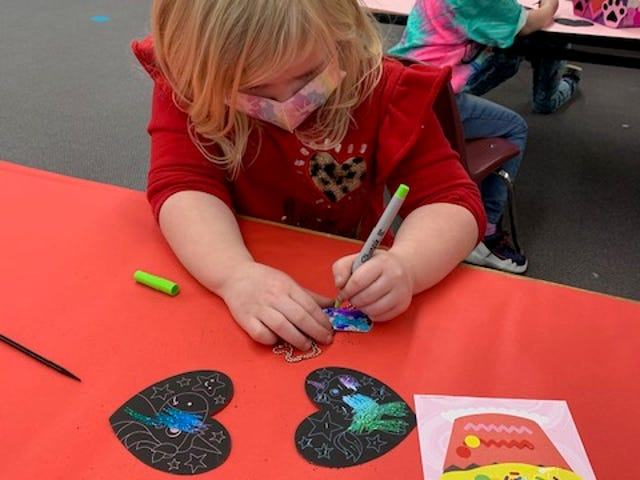 Students at B.L. Miller Elementary School celebrated Valentine's Day a little early, with parties last week at the school before a long Presidents Day weekend break.  Here, a youngster takes part in a craft activity in her class.