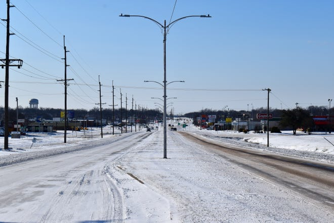 Traffic was light on South Commerce Street Monday, Feb. 15, 2021, after several inches of snow fell on Ardmore over the weekend.