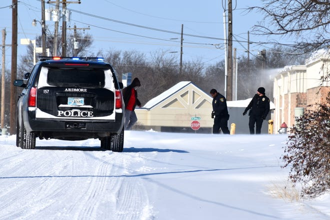 Ardmore police walk back to their vehicle after helping a stranded motorist Monday, Feb. 15, 2021.