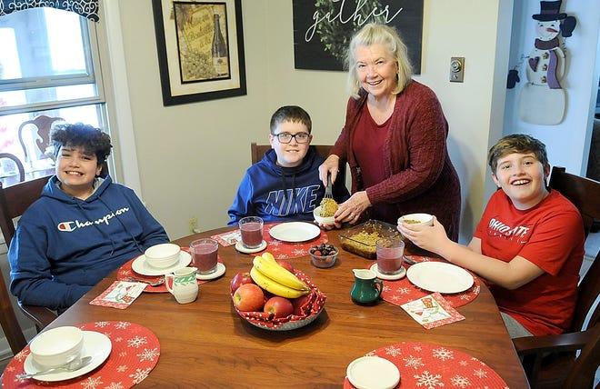 Peg Bevington serves her grandchildren, from left, Quincy Camacho, Boden Macaulay and Joseph Camacho her baked oatmeal recipe. TOM E. PUSKAR/TIMES-GAZETTE.COM
