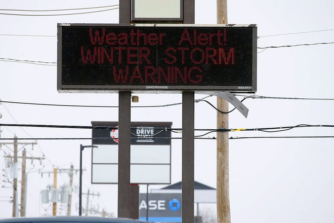 A sign outside a pharmacy during a winter storm in Oklahoma City, Sunday.
