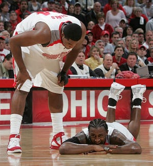Ohio State center Terence Dials checks on teammate Je'Kel Foster, who was shaken up in overtime of the Buckeyes' tough loss to Michigan State on Jan. 15, 2006.