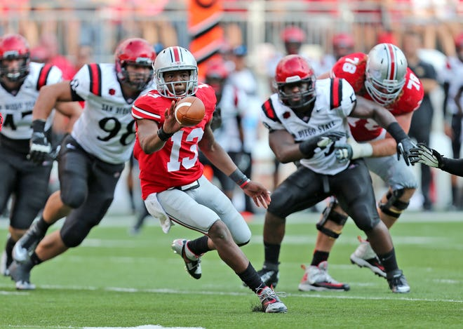 Quarterback Kenny Guiton (13) became a favorite of Ohio State fans for his work in relief of starter Braxton Miller.