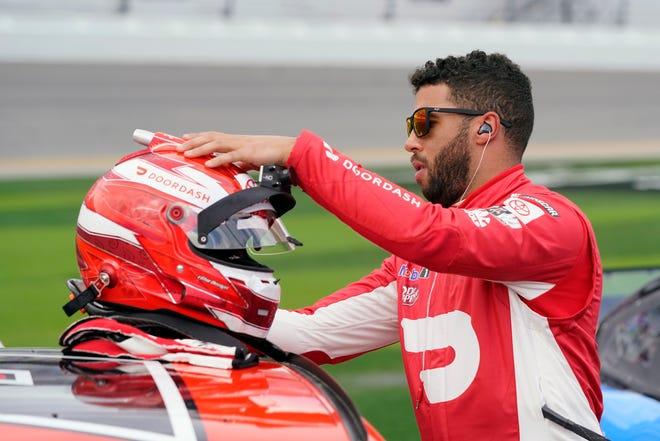 Bubba Wallace checks his helmet before the Daytona 500 on Sunday.