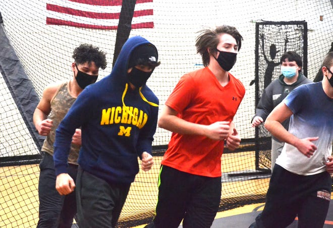 Cheboygan wrestlers jog during a practice held back in January. The Chiefs went 2-1 overall at their season-opening meet at Rudyard on Saturday.
