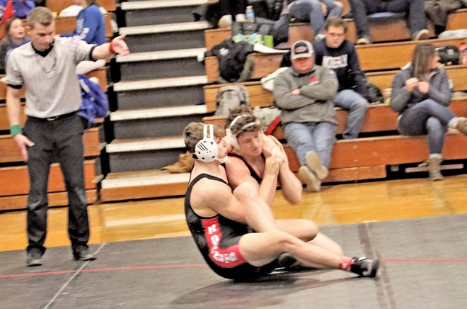 Sophomore Brock Miller of Chillicothe High School firms up his control of Odessa's Hunter Riley prior to rolling Riley backward onto his shoulders and earning a surprising 53-seconds win in the title bout of the 182-pounds weight division of the Class 2 District 7 Tournament at the Chillicothe Middle School fieldhouse last Saturday.