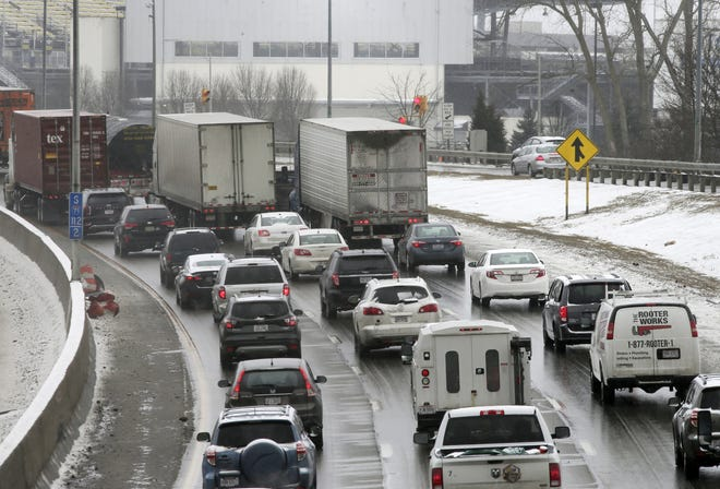 Southbound traffic on Interstate 71 slows to a crawl near Mapfre Stadium between 17th Avenue and Hudson after an accident involving multiple vehicles on Monday morning. A layer of snow that fell overnight caused multiple crashes Monday morning.