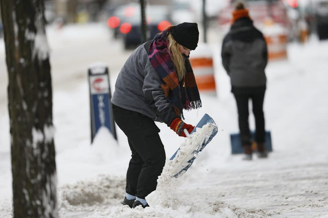 Experts suggest filling the shovel only half-way while shoveling, or pushing the snow instead, to protect your back and heart