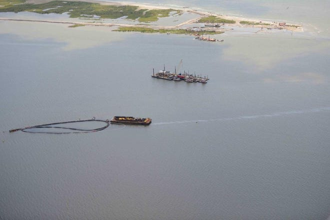 A small oily sheen is shown in the water in 2016 at Chenier Ronquille Island, about 10 miles northeast of Grand Isle, in 2016.