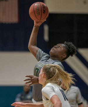 The Villages' Re'Nae Brant (10) goes up for a basket against South Lake on Jan. 15 in Groveland. The Buffalo will host Crystal River Tuesday in a Class 4A regional semifinal contest. [PAUL RYAN / CORRESPONDENT]
