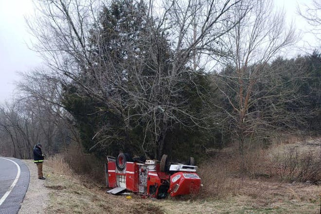 A Maury County Fire Department engine was responding to an emergency when it overturned after slipping on black ice on Highway 166 North in Hampshire, Tenn., Sunday, Feb. 14, 2021.