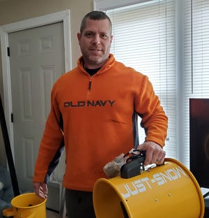 Justin Beck, holds one of the two kinds of snow guns he makes for snow blowing systems he makes and sells for his Just-Snow business. He often delivers the snowmaking machines to customers all over the country, from Connecticut and Wisconsin to Minnesota and Florida.