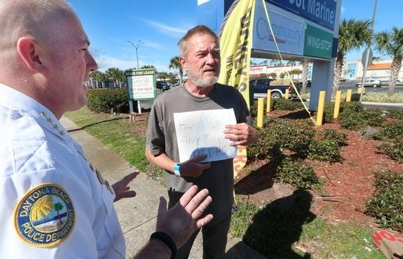 Former Daytona Beach Police Chief Craig Capri gives a warning to a panhandler shortly after the city passed an anti-panhandling ordinance last year.