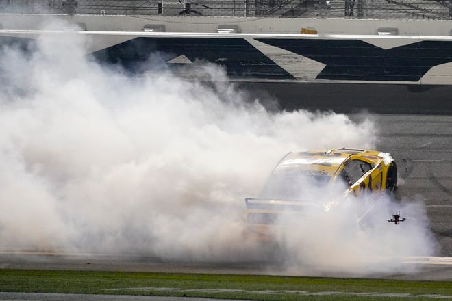 Michael McDowell celebrates after winning the NASCAR Daytona 500 auto race at Daytona International Speedway, Monday, Feb. 15, 2021, in Daytona Beach, Fla.
