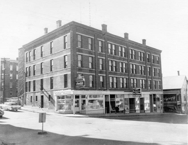 The Phyllis Block, featuring the Gardner Pharmacy, in Gardner circa 1964.