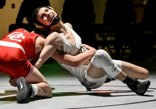 Garden City High School's Julius Medina, right, works on a reversal against Dodge City's Jose Medina in a 106-pounds match during a wrestling dual in January at GCHS. Medina took first place in his weight class Friday in a 6A regional wrestling tournament at Dodge City.
