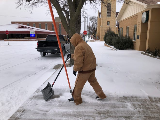 Michael Billinger, an employee of Field Abstract & Title Co., 1201 Fort St., shovels snow early Sunday morning at that office, as deep-freeze temperatures registered minus 1 degree in Hays.