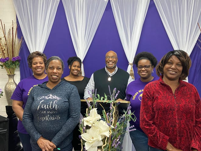 Agape World Outreach Praise Team, from left to right, Tijuna Green, Compton Tucker, YaShara Lynch, Charne Tucker and Linda Smith, are shown with Prelate Apostle Scott Elliot, middle.