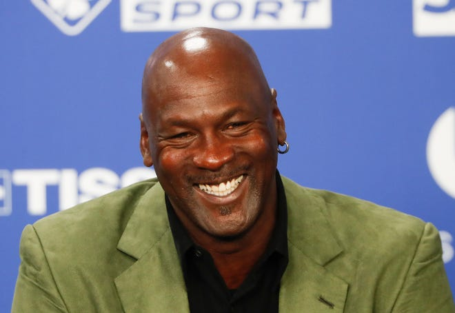 Basketball legend Michael Jordan speaks during a press conference ahead of an NBA basketball game between the Charlotte Hornets and Milwaukee Bucks in Paris in this Friday, Jan. 24, 2020 photo. Jordan is donating $10 million to launch two medical clinics in underserved communities near his hometown in North Carolina, a regional health care system announced Monday. (AP Photo/Thibault Camus, File)