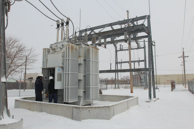Evergy employees work on the power station at 14th and Lorraine on Monday, Feb. 15.