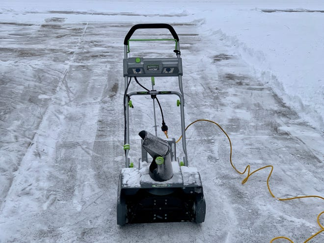 The Earthwise SN72018 Electric Corded 13.5 amp snow thrower made quick work of a snow-covered Peoria driveway.