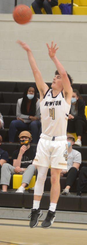Newton junior Tanner Dorrell takes a jumper during play Saturday against Campus.