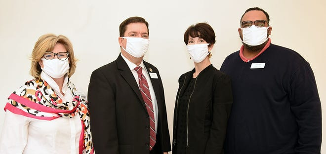 Masked up with a few of the 55,000 washable face masks donated to Lenoir County Public Schools through America's Mask Challenge are, from left, Associate Superintendent Frances Herring, Superintendent Brent Williams, Lenoir-Greene United Way Executive Director Molly Taylor and Assistant Superintendent Nicholas Harvey II. Lenoir-Greene United Way provided local coordination for the national campaign, a partnership of United Way Worldwide, the Business Roundtable and the CDC Foundation. [CONTRIBUTED PHOTO]