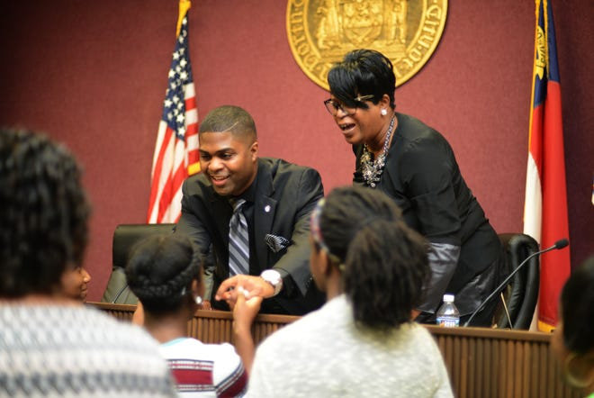 Mayor Don Hardy and Mayor Pro Tem Felicia Solomon greet children and members of the community Monday after the ceremony for Kinston's new mayor and City Council members.