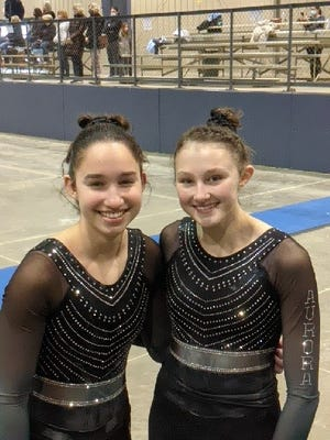 Kaitlin Zgonc and Hannah Salgado of Aurora advanced to the OHSAA district championships.