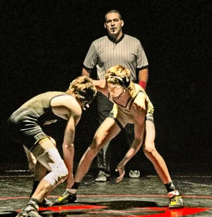 Marceline High School wrestling Tiger Canaan Wright looks for an opening to attack during a 120-pounds bout against Hunter McAtee of Trenton during a dual match in Chillicothe Feb. 2. Wright took the 120-pounds division Class 1 District 7 championship last Saturday at home, wrestling only once and pinning a Macon opponent in only 31 seconds.