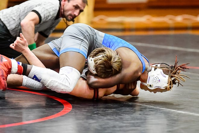 """Brookfield High School junior Jaden Abongo tries finish a pin of Gallatin's Draven Wright during their bout in dual match at Chillicothe Jan. 14. Abongo settled for a major decision on that occasion and just missed another when he defeated Wright 12-5 in the championship bout of the 145-pounds weight division of the Class 1 District 7 tournament at Marceline last Saturday. ( W.L. """"BUTCH"""" SHAFFER / LCL FILE PHOTO )"""