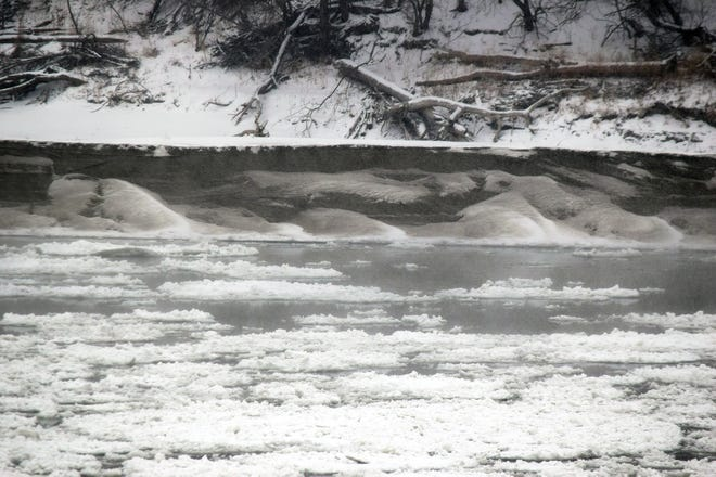 Ice flows down the Missouri River on Monday in the area of Landing Park in Leavenworth.