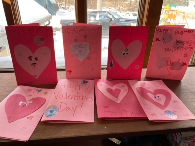 Girls from Penfield's Millwheel SU, Daisy Troop 60824 make valentines for residence at Penfield Place.
